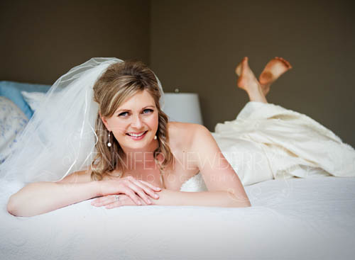 Bride lying down. Photo by www.jnphotography.ca @filemanager
