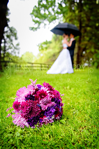 Wedding couple with bouquet in foreground by www.jnphotography.ca @filemanager