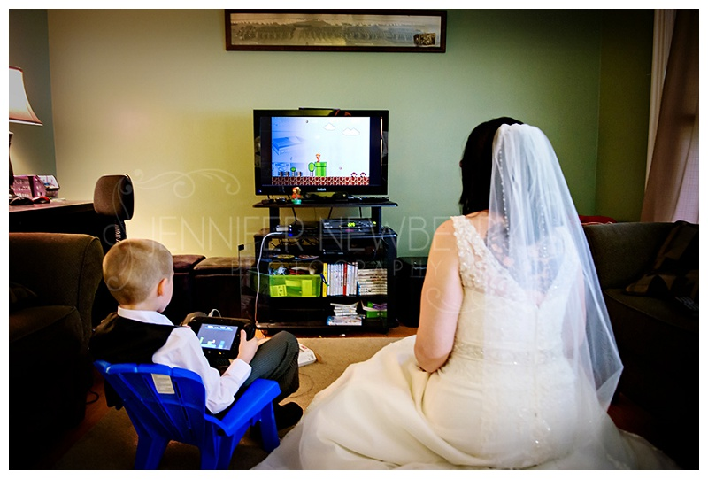 Bradford bride plays video games with her son. Photos by Bradford wedding photographer www.jnphotography.ca @filemanager