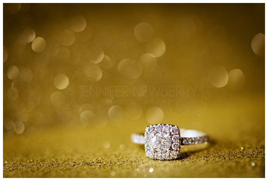Engagement ring with gold bokeh background. Photo by King's Riding wedding photographer www.jnphotography.ca @filemanager